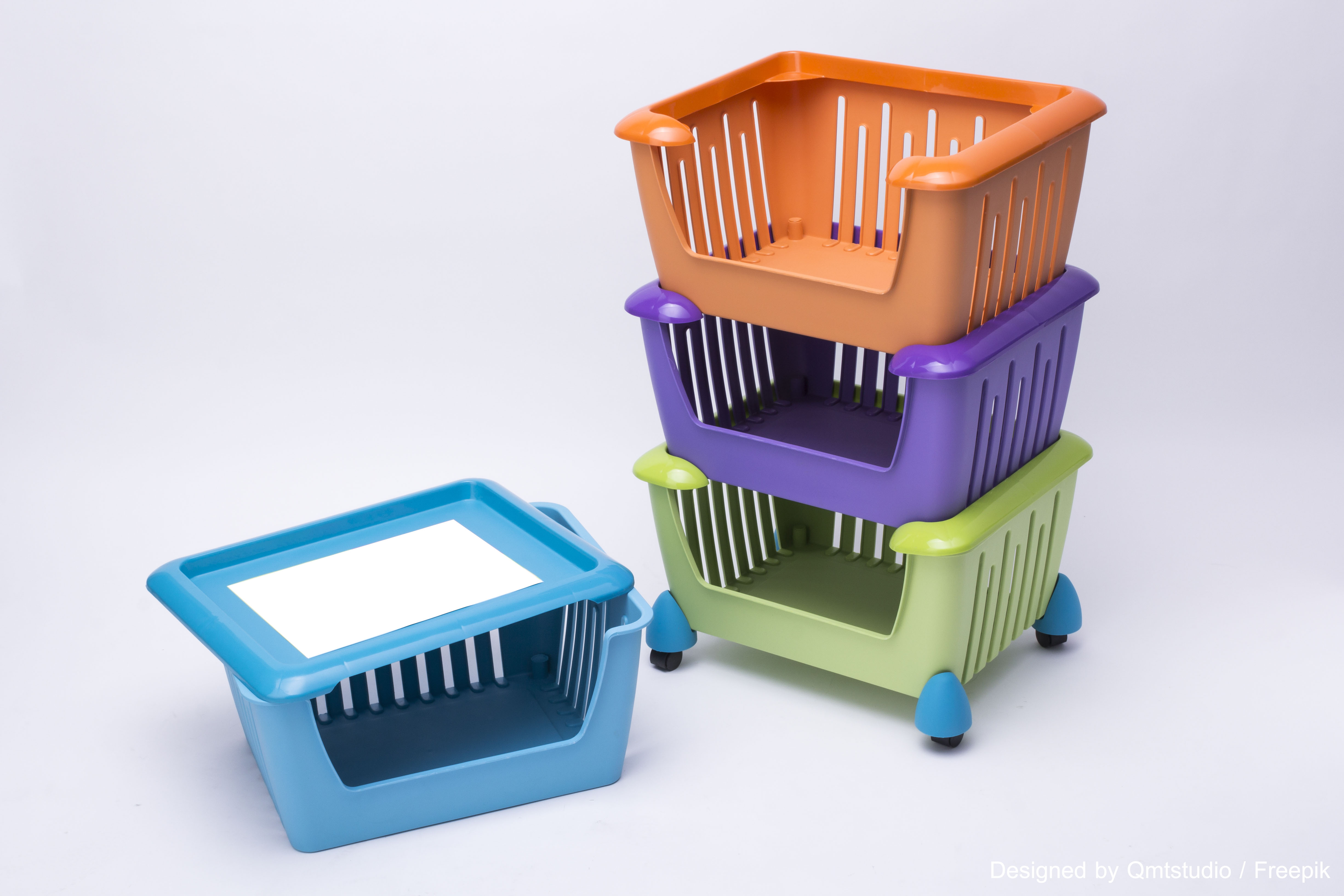 Color plastic basket on white background